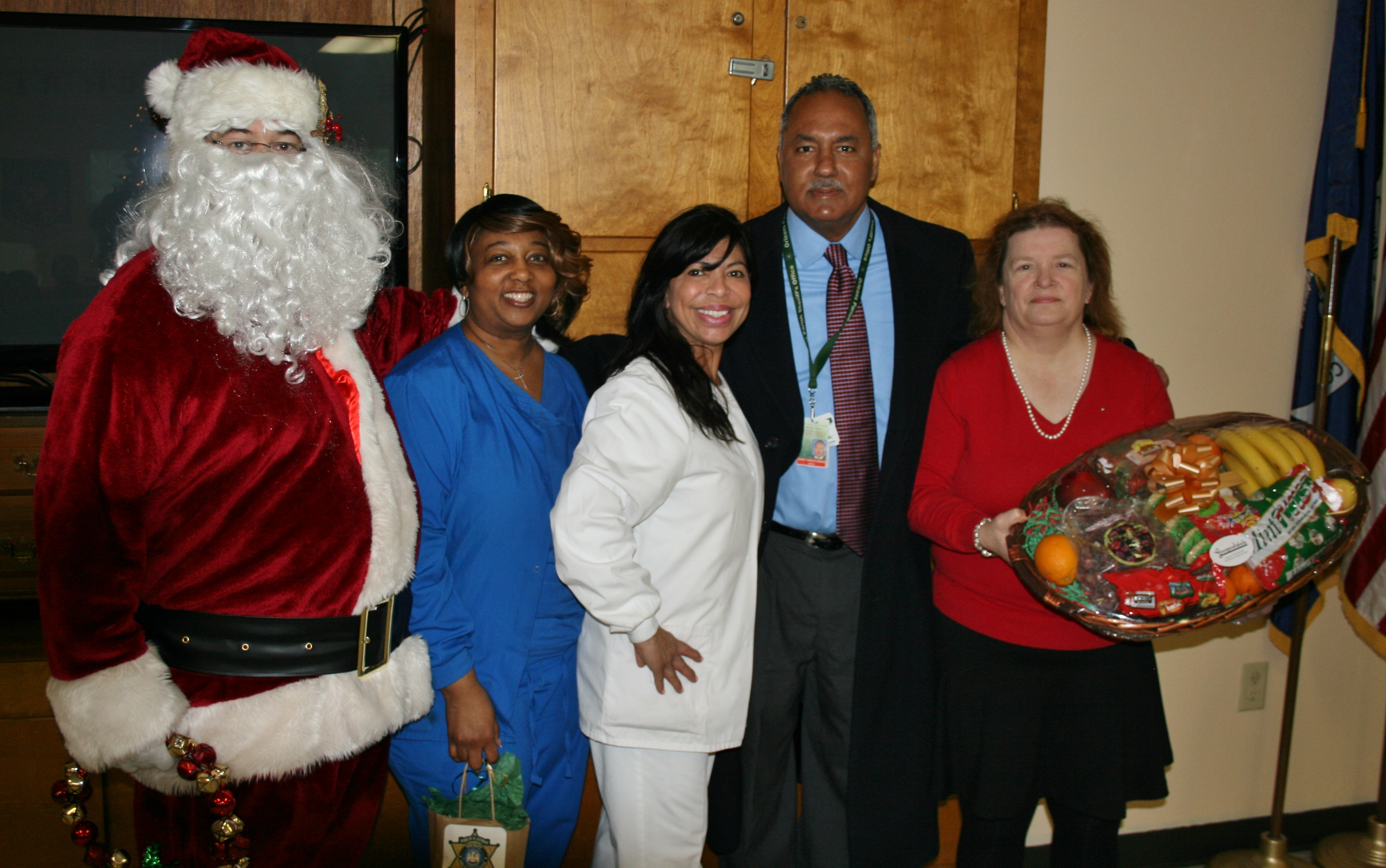 Sheriff Gusman and Santa Claus bring gift bags and baskets to the residents and staff of the John J. Hainkel Rehabilitation Home.